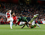 Arsenal's Olivier Giroud gets rugby tackled by Doncaster's Andy Butler but no penalty is given during the Carabao cup match at the Emirates Stadium, London. Picture date 20th September 2017. Picture credit should read: David Klein/Sportimage
