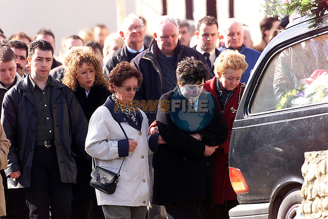 Mary Gough (in black) is comforted at the funeral of her daughter Mary Whelan in Stamullen, Co. Meath. Her daughter Mary (27) originally from Cockhill, Stamullen, was strangled at her home in Clonard Street, Balbriggan, early on Thursday morning. Gardai in Balbriggan have launched a murder hunt following the results of her post mortem..Picture: Paul Mohan/Newsfile