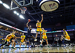 SIOUX FALLS, SD - MARCH 8: Deondre Burns #2 of the Oral Roberts Golden Eagles lays the ball up past Tyson Ward #24 of the North Dakota State Bison at the 2020 Summit League Basketball Championship in Sioux Falls, SD. (Photo by Richard Carlson/Inertia)