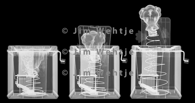 X-ray image of a jack-in-the-box sequence (white on black) by Jim Wehtje, specialist in x-ray art and design images.