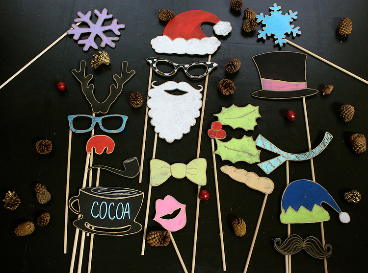 Make your holiday pictures fun and full of personality with Tummy Tickles Designs Wooden Christmas Photo Booth Props.  These wooden chalkboard props are delivered undecorated and ready for you to personalize. They are durable yet lightweight props, which can be reused for future holiday celebrations.<br />