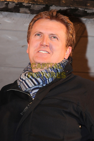 ALED JONES .Switches on the Christmas lights in  Basildon, Essex, England, UK, .18th November 2010.portrait headshot smiling striped scarf grey gray black .CAP/BRC.©Ben Rector/Capital Pictures.