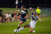 FC Kansas City midfielder Jen Buczkowski (6) goes for a tackle on Sky Blue FC defender Caitlin Foord (4). Sky Blue FC and FC Kansas City played to a 2-2 tie during a National Women's Soccer League (NWSL) match at Yurcak Field in Piscataway, NJ, on June 26, 2013.