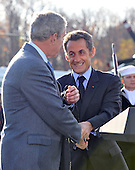 Camp David, MD - October 18, 2008 --  President Nicolas Sarkozy of France, who also serves as this year's rotating President of the European Union (EU), right, shakes hands with United States President George W. Bush, left, after making remarks at the Presidential Retreat near Thurmont, Maryland for talks on Saturday, October 18, 2008.  Sarkozy and Barosso stopped at Camp David to meet with President Bush to discuss the economy on their way home from a summit in Canada to try to convince Bush to support a summit by year's end to try to reform the world financial system..Credit: Ron Sachs / Pool via CNP