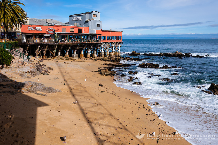 United States, California, Monterey. A beach on the waterfront in the city of Monterey.