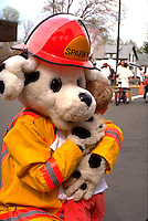 Sparky the fire department mascot hugging boy age 35 and 5.  St Paul  Minnesota USA