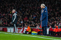 ( L-R ) Alan Curtis, First-team coach of Swansea City and Arsene Wenger Manager of Arsenal look on during the Barclays Premier League match between Arsenal and Swansea City at the Emirates Stadium, London, UK, Wednesday 02 March 2016