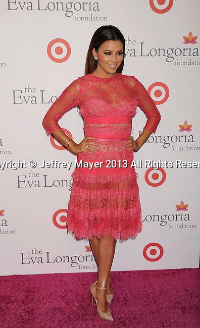 HOLLYWOOD, CA- SEPTEMBER 28: Actress Eva Longoria arrives at the Eva Longoria Foundation Dinner at Beso restaurant on September 28, 2013 in Hollywood, California.