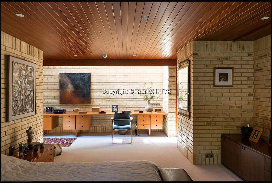 BNPS.co.uk (01202 558833)<br /> Pic: French+Tye/BNPS<br /> <br /> Once described as 'the best modern house in the world' - the concrete, timber and copper structure looks as modern today as it did over 50 years ago.<br /> <br /> A modernist property designed by the man behind the world famous Sydney Opera House has hit the market for £3.5m. <br /> <br /> Ahm House in Harpenden, Herts, is the breathtaking creation of renowned architect, Jorn Utzon, who in the early 1960s was simultaneously working on Australia's most famous landmark. <br /> <br /> In 1962 Utzon constructed the home for fellow Dane, Povl Ahm, with whom he became friends while working on the Opera House together. <br /> <br /> Government body Historic England recognised the building as an architectural wonder in 1998 by granting it Grade II listed status.
