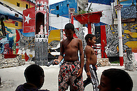 Children play in front a mural in Havana, Cuba on 6 August 2006.<br />