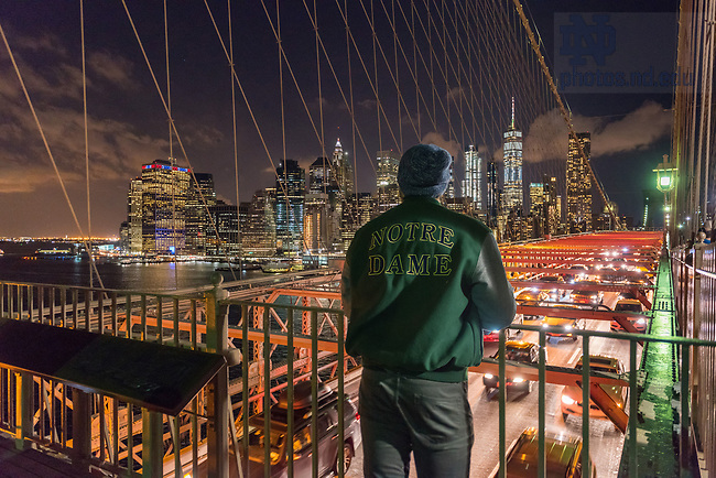 November 8, 2017; A junior civil engineering student, Adam Kuczynski, takes in the view of Manhattan from the Brooklyn Bridge on the first day of the 2017 Department of Civil and Environmental Engineering and Earth Science, (CEES), Junior Class Field Trip to New York City.  (Photo by Barbara Johnston/University of Notre Dame)