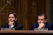 UNITED STATES - SEPTEMBER 27: Sen. Ben Sasse, R-Neb., left, and Sen. Ted Cruz, R-Texas, listen as Judge Brett Kavanaugh testifies during the Senate Judiciary Committee hearing on his nomination be an associate justice of the Supreme Court of the United States, focusing on allegations of sexual assault by Kavanaugh against Christine Blasey Ford in the early 1980s. (Photo By Tom Williams/CQ Roll Call/POOL)