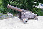 Alaska, Sitka..Russian cannon below Castle Hill..Photo copyright Lee Foster, 510/549-2202, lee@fostertravel.com, www.fostertravel.com.