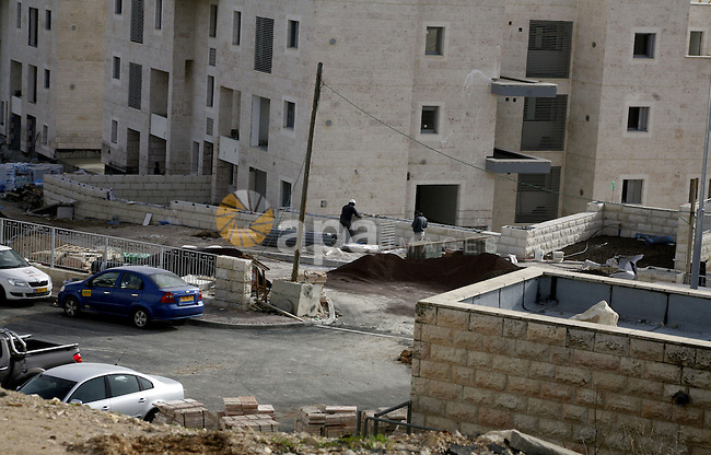 "Labourers work at the construction site of a new housing project at the Jewish settlement of Kiryat Moreh in south Jerusalem on December 20, 2012. Israel has approved plans to build 523 homes in the West Bank, Jewish settlers said, in the first step towards a new settlement ""city"" that drew furious condemnation from the Palestinians. Photo by Mahfouz Abu Turk"
