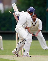 S Dishon of Shepherds Bush turns round to see his bails flying through the air after being bowled by Joel Gregory during the Middlesex County League Division two game between Shepherds Bush and Hornsey at Bromyard Avenue, East Acton on Sat July 23, 2011