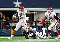 Hawgs Illustrated/Ben Goff<br /> Otaro Alaka, Texas A&M linebacker, tackles Rakeem Boyd, Arkansas running back, in the 1st quarter Saturday, Sept. 29, 2018, during the Southwest Classic at AT&T Stadium in Arlington, Texas.