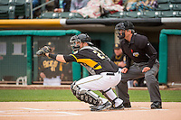 Salt Lake Bees catcher Jett Bandy (27) catches a pitch as home plate umpire Greg Stanzak looks on during the Pacific Coast League game against the Colorado Springs Sky Sox at Smith's Ballpark on May 22, 2015 in Salt Lake City, Utah.