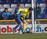 Sean Kelly being put under pressure by Billy McKay in the Inverness Caledonian Thistle v St Mirren Scottish Professional Football League Premiership match played at the Tulloch Caledonian Stadium, Inverness on 29.3.14.