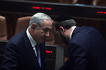 Israeli Prime Minister Benjamin Netanyahu (L) is seen during a no-Confidence in Israel's Parliament (Knesset) in Jerusalem, June 15, 2009. Yesterday Netanyahu gave his much anticipated policy speech at Bar-Ilan University, which angered many on the Palestinian side but received luke-warm acceptance from the United States. Photo By: Tess Scheflan / JINI .