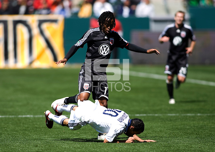 LA Galaxy's Landon Donovan is taken down by DC's Luciano Emilio. The LA Galaxy and DC United play to 2-2 draw at Home Depot Center stadium in Carson, California on Sunday March 22, 2009.