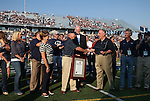 Reno Mayor Bob Cashell, right center, honors former Nevada head coach Chris Ault in a pre-game ceremony renaming Mackey Stadium as Chris Ault Field, in Reno, Nev., on Saturday, Sept. 7, 2013. (AP Photo/Cathleen Allison)