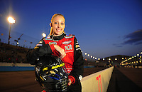 Apr 16, 2009; Avondale, AZ, USA; NASCAR Camping World Series West driver Kristin Bumbera poses for a portrait prior to the Jimmie Johnson Foundation 150 at Phoenix International Raceway. Mandatory Credit: Mark J. Rebilas-