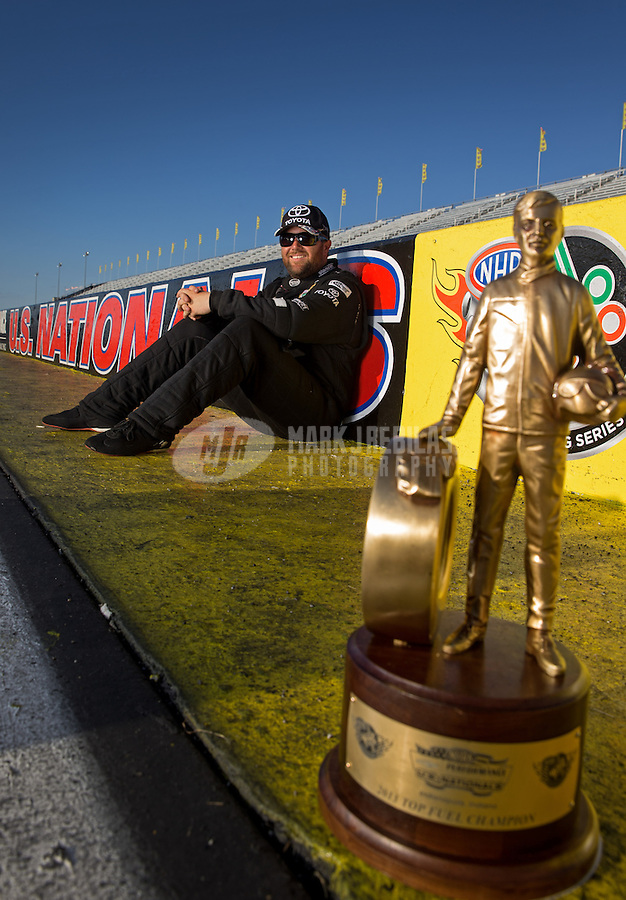 Sept. 2, 2013; Clermont, IN, USA: NHRA top fuel dragster driver Shawn Langdon poses for a portrait after winning the US Nationals at Lucas Oil Raceway. Mandatory Credit: Mark J. Rebilas-