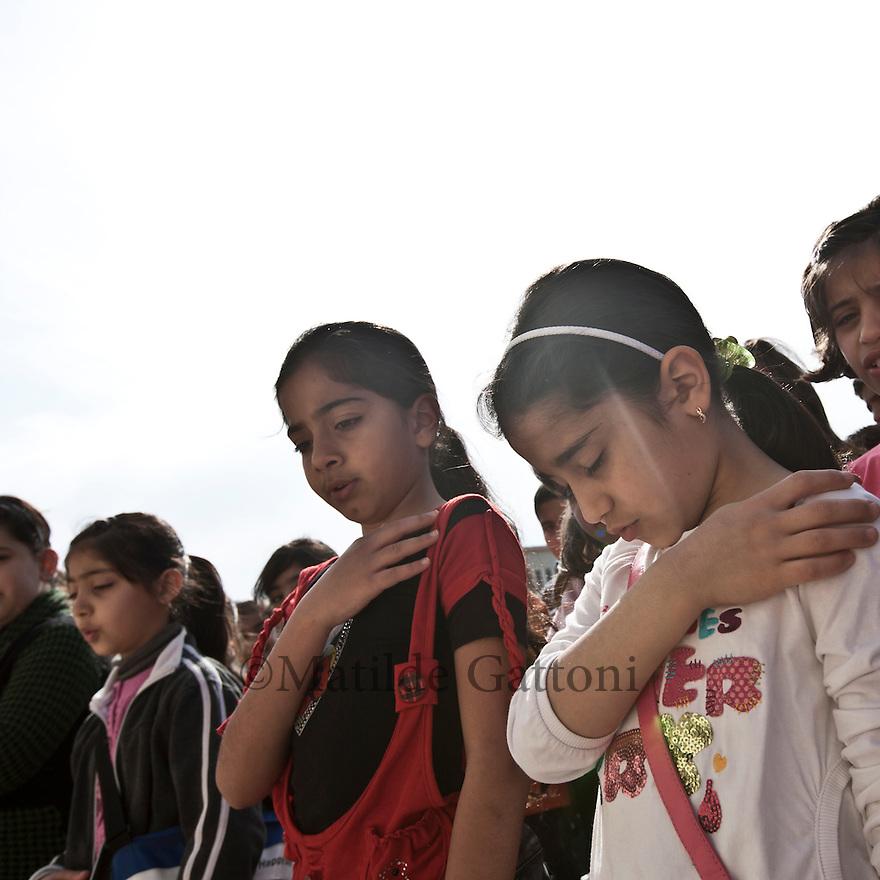 Iraq - Kurdistan - Ankawa - Children singing religious songs outside St Joseph Cathedral.