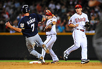 Jun. 30, 2008; Phoenix, AZ, USA; Arizona Diamondbacks shortstop Stephen Drew (right) looks on as second baseman Augie Ojeda forces out Milwaukee Brewers base runner J.J. Hardy as he throws to first base to complete the double play in the fifth inning at Chase Field. Mandatory Credit: Mark J. Rebilas-