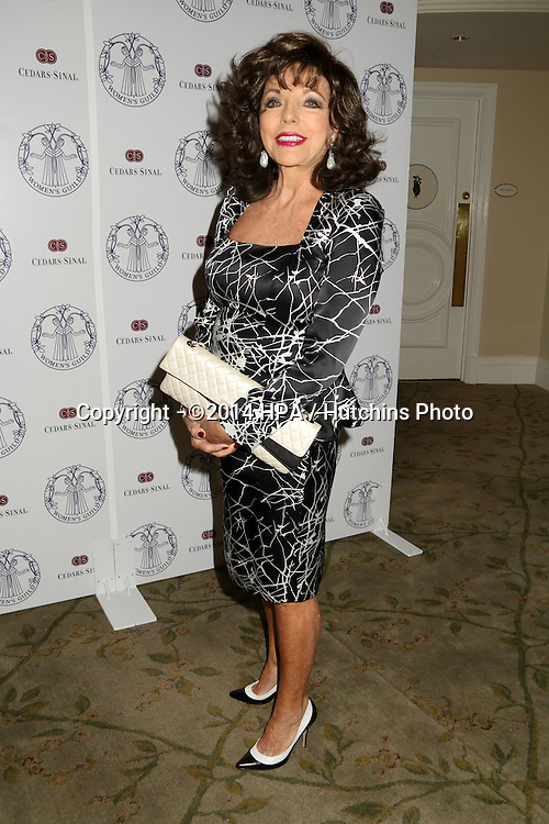 LOS ANGELES - APR 22:  Joan Collins at the Women's Guild Cedars-Sinai Luncheon at Beverly Hills Hotel on April 22, 2014 in Beverly Hills, CA