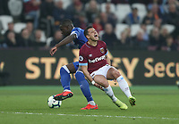 West Ham United's Javier Hernandez is challenged by Everton's Kurt Zouma<br /> <br /> Photographer Rob Newell/CameraSport<br /> <br /> The Premier League - West Ham United v Everton - Saturday 30th March 2019 - London Stadium - London<br /> <br /> World Copyright © 2019 CameraSport. All rights reserved. 43 Linden Ave. Countesthorpe. Leicester. England. LE8 5PG - Tel: +44 (0) 116 277 4147 - admin@camerasport.com - www.camerasport.com