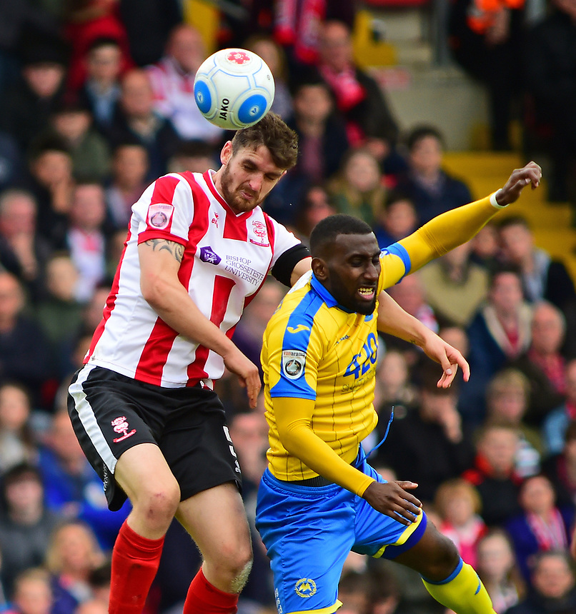 Lincoln City's Luke Waterfall vies for possession with Torquay United's Lathaniel Rowe-Turner<br /> <br /> Photographer Andrew Vaughan/CameraSport<br /> <br /> Vanarama National League - Lincoln City v Torquay United - Friday 14th April 2016  - Sincil Bank - Lincoln<br /> <br /> World Copyright &copy; 2017 CameraSport. All rights reserved. 43 Linden Ave. Countesthorpe. Leicester. England. LE8 5PG - Tel: +44 (0) 116 277 4147 - admin@camerasport.com - www.camerasport.com