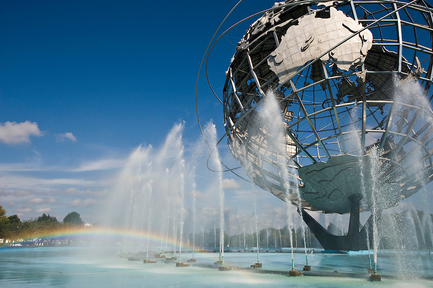A small rainbow forms in the water fountains of the Unisphere, also known as the Globitron, in Flushing Meadows Park, in the borough of Queens, New York City on a bright sunny afternoon. Originally built in April 1964 for the New York World's Fair, is currently the site of the U.S. Open tennis championship.