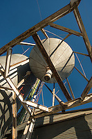 I was standing under the huge funnel of a grain hopper used to facilitate loading grain onto a railway car in the American west.