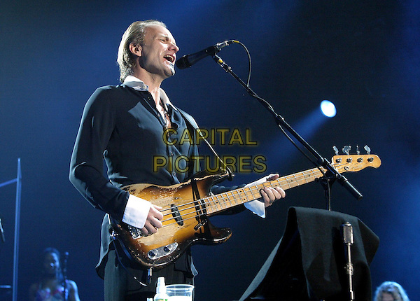 STING.In concert in Milan.November 30th, 2004.half length, concert, satge, live, gig, performance, singing, guitar.www.capitalpictures.com.sales@capitalpictures.com.© Capital Pictures.