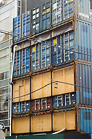 A single-family home constructed out of shipping containers is seen under construction in the Williamsburg neighborhood of Brooklyn on Tuesday, February 18, 2014. The private mansion, designed by the architectural firm LOT-EK is made of 21 containers stacked onto a 25 X 100 corner lot. The design of the home echoes the industrial, working-class nature of the neighborhood despite the number of wealthy moving in.  (© Richard B. Levine)