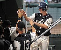 June 20, 2009: Mitch Dening (17) is congratulated by fellow Greenville Drive players after he scored during a game that clinched the first half Southern Division title for the South Atlantic League. The Drive took the title with a 15-3 win over the Lexington Legends at Fluor Field at the West End in Greenville, S.C. Drive players were wearing Greenville Mill League throwback jerseys that were being auctioned off after the game. Photo by: Tom Priddy/Four Seam Images