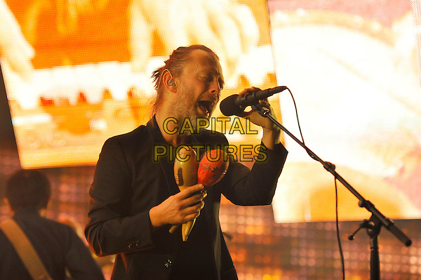 Thom Yorke.Radiohead performing live in concert, o2 Arena, Greenwich, London, England. .8th October 2012.on stage in concert live gig performance music half length black suit jacket singing maracas beard facial hair.CAP/MAR.© Martin Harris/Capital Pictures.