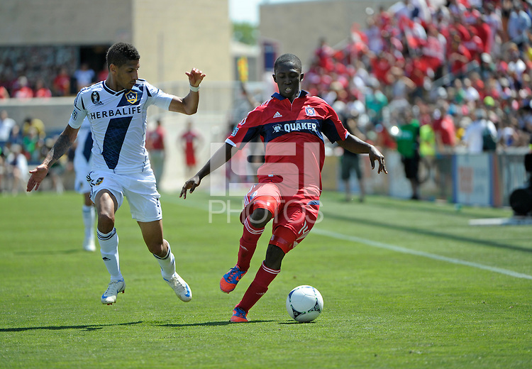 Chicago midfielder Patrick Nyarko (14) maneuvers away from LA Galaxy defender Sean Franklin (5).  The LA Galaxy defeated the Chicago Fire 2-0 at Toyota Park in Bridgeview, IL on July 8, 2012.