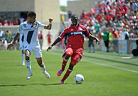 Chicago midfielder Patrick Nyarko (14) maneuvers away from LA Galaxy defender Sean Franklin (5).  The LA Galaxy defeated the Chicago Fire 2-0 at Toyota Park in Bridgeview, IL on July 8, 2012.