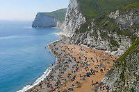 BNPS.co.uk (01202 558833)<br /> Pic: Graham Hunt/BNPS<br /> <br /> Visitors flock to to Durdle Door in Dorset on a scorching hot sunny day.<br /> <br /> The beach at Durdle Door is packed with sunbathers..