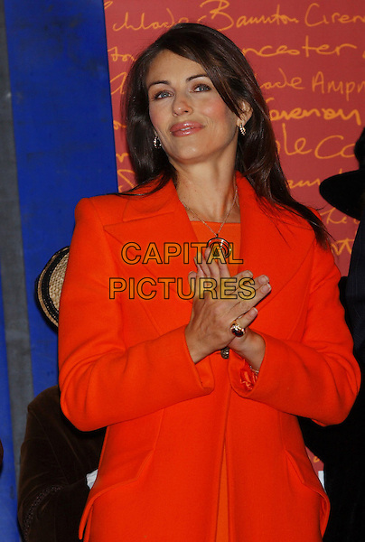 ELIZABETH HURLEY.guest of honour at the switching on of Christmas lights in Cirencester, Gloucestershire.21/11/2003 .liz, half length, half-length, clapping hands.sales@capitalpictures.com.www.capitalpictures.com.©Capital Pictures