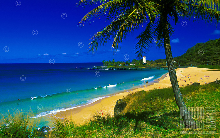Beachgoers enjoying Waimea Bay, North Shore, Oahu