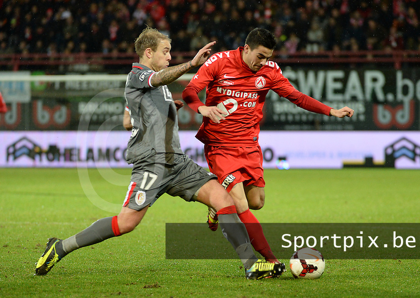 20131227 - KORTRIJK, BELGIUM : Kortrijk's Gregory Mahau pictured being tackled by Standard's Yoni Buyens (l) during the Jupiler Pro League match between KV Kortrijk and Standard de Liege in Kortrijk, Friday 27 December 2013, on the twenty-first day of the Belgian soccer championship. PHOTO DAVID CATRY