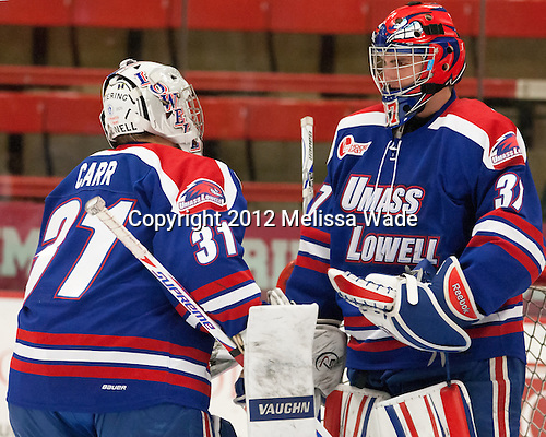 Doug Carr (UML - 31), Connor Hellebuyck (UML - 37) - The visiting University of Massachusetts Lowell River Hawks defeated the Harvard University Crimson 5-0 on Monday, December 10, 2012, at Bright Hockey Center in Cambridge, Massachusetts.