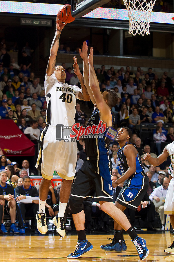 Ty Walker #40 of the Wake Forest Demon Deacons shoots over Mile Plumlee #21 of the Duke Blue Devils at the LJVM Coliseum on February 28, 2012 in Winston-Salem, North Carolina.  The Blue Devils defeated the Demon Deacons 79-71.  (Brian Westerholt / Sports On Film)