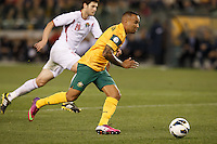 MELBOURNE, 11 JUNE 2013 - Archie THOMPSON of Australia controls the ball in a Round 4 FIFA 2014 World Cup qualifier match between Australia and Jordan at Etihad Stadium, Melbourne, Australia. Photo Sydney Low for Zumapress Inc. Please visit zumapress.com for editorial licensing. *This image is NOT FOR SALE via this web site.