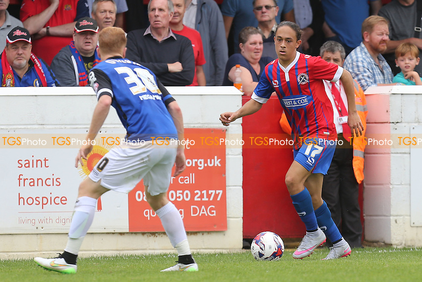 Jodi Jones of Dagenham and Connor Ogilvie of Stevenage during Dagenham and Redbridge vs Stevenage, Sky Bet League 2 Football at the London Borough of Barking and Dagenham Stadium, London, England on 29/08/2015