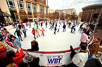 Ice skaters enjoy the temporary outdoor ice rink in Uptown Charlotte over the winter holidays. WBT Holiday on Ice is located in The Green Uptown, a scenic downtown park.