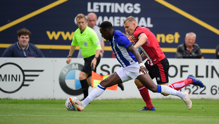 Lincoln City's Harry Anderson vies for possession with Sheffield Wednesday's Moses Odubajo<br /> <br /> Photographer Chris Vaughan/CameraSport<br /> <br /> Football Pre-Season Friendly - Lincoln City v Sheffield Wednesday - Saturday July 13th 2019 - Sincil Bank - Lincoln<br /> <br /> World Copyright © 2019 CameraSport. All rights reserved. 43 Linden Ave. Countesthorpe. Leicester. England. LE8 5PG - Tel: +44 (0) 116 277 4147 - admin@camerasport.com - www.camerasport.com